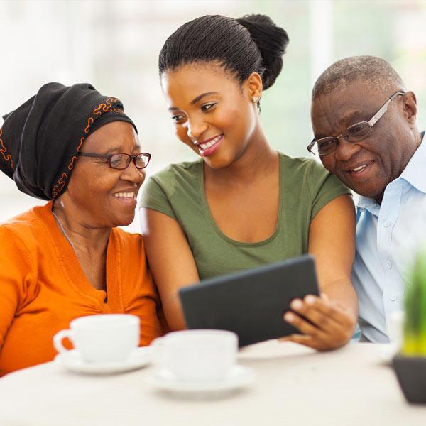 seniors reading email on tablet
