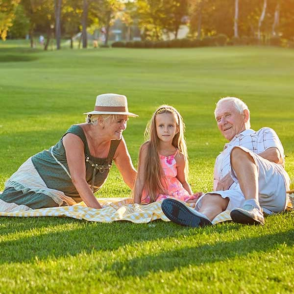 Grandparents on picnic with grandaughter