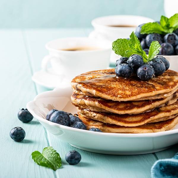 Stack of multigrain pancakes with blueberries