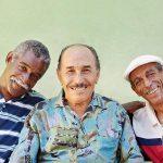 Three smiling older men posing together