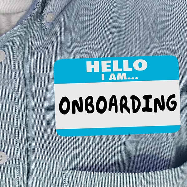 Shirt with sticker 'Hello I am Onboarding""